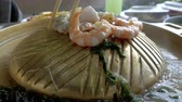 Shrimps cooked on frying pan at Thai traditional buffet