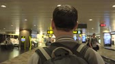 バックパッキング : Man riding travalator at airport. Male traveler on trip 動画素材