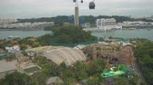 a view : Riding on cable car above theme park, view from cabin