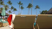 papai noel : Santa Claus Hat Hanging on Sunbed