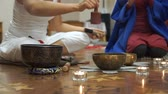 Women meditate and do yoga. The Tibetan singing bowls. Master class for creative group