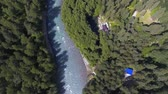 Shooting from a birds eye view. Flying over the river and forests of the St. Sophia ridge. Russia Arkhyz