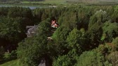 Shooting from a helicopter, the suburban real estate. Cottage village in the forest 4K