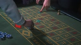 gaming chips : Betting chips - Casino Roulette People playing Roulette. Close-up only hands Stock Footage