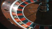 povznášející : A shot of a casino roulette in motion,the ball stops at 27 red thirty sixBetter luck next time