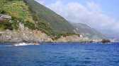 Blue sea and mountains with vine terraces in Monterosso al Mare, Cinque Terre, Italy, sunny day
