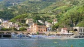 Beach, blue sea and mountains in Monterosso al Mare, Cinque Terre, Italy, sunny day