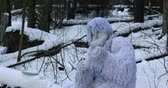 neanderthal : Yeti fairy tale character in winter forest. Outdoor fantasy 4K footage.