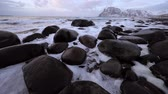 Ancient stones on the shores of cold Norwegian Sea. Lofoten islands. Beautiful Norway landscape.