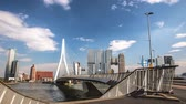 General view of Rotterdam city landscape and Erasmus bridge one of the most famous symbols of the city at day time. 4K Time Lapse Footage.