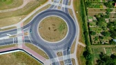 Roundabout intersection in three directions with island, aerial view