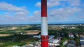 передатчик : Flying along high chimney in power plant factory, aerial view