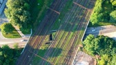 Aerial view on multiple rail track crossing with road