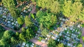 maradványok : Aerial view of big cemetery. Many tombstones and trees, slow flight