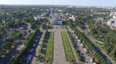 statue : Aerial view of architecture of VDNKh park in Moscow. VDNH is a large city park, exhibition center and amusement park, popular touristic landmark Stock Footage