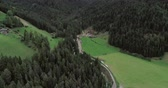 val di funes : Amazing aerial shot of Dolomiti mountain on a cloudy autumn day. Flying above beautiful green forest in Santa Maddalena in Val di Funes, Dolomites, Italy with view over Italian Alps. Stock Footage