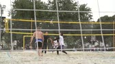 залп : Russia, Moscow - June 1, 2017 : Many young unidentified people playing volleyball outdoors in park in Moscow, Russia on June, 2017