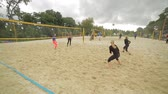 beach ball : Russia, Moscow - June 1, 2017 : Many young unidentified people playing volleyball outdoors in park in Moscow, Russia on June, 2017