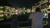 FENGHUANG, HUNAN, CHINA - September 25, 2017: The Old Town of Phoenix (Fenghuang Ancient Town) at night. The popular tourist attraction which is located in Fenghuang County, Hunan, China.