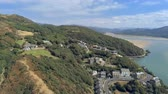 cerceta : Aerial view, pan move. Drone panorama over sea, hills and buildings, Barmouth, Wales