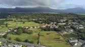 snowdonia : Aerial view, rise up move. Drone panorama of town in Snowdonia mountains in Wales