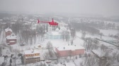 fieldwork : A red helicopter is flying over the snowy city. Stock Footage
