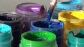 pot de peinture : brush immersed in a jar of blue Acrylic gouache paint. Homework,