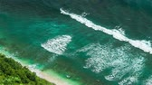 puré : Aerial view of waves rolling one by one to the Nunggalan Beach near Uluwatu, Bali, Indonesia