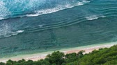 mırlamak : Top view perspective of waves rolling one by one to the Nunggalan Beach, Uluwatu, Bali, Indonesia Stok Video