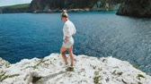 strohhut : Blonde Woman on vacation in Greece walking along the white cliffs enjoying amazing landscape on Cefalonia Kefalonia Island. Vacation travel adventure carefree joy and happiness concept. Slow motion.