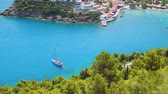 must see : Luxury Sailing yacht in the blue bay. Vacations in mediterenean sea. Colorful harbor, remote nature of Assos village, secluded Islands in Greece. Travel adventure carefree and happiness concept.