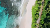 Aerial forward flight 4K drone of bizarre paradise tropical beach Anse Bazarca at Mahe island, Seychelles. Summer vacation, travel and lifestyle concept Vídeos