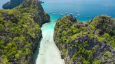 Big Lagoon, El Nido, Palawan, Philippines. Drone aerial fly between limestone cliffs above shallow water on entrance. Most visited Island Hopping Tour A