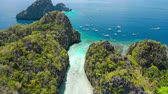 nézett : Entrance into the Big Lagoon, El Nido, Palawan, Philippines. Drone aerial fly over limestone cliffs and blue shallow water. Most visited Island Hopping Tour A