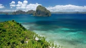 must see : Aerial drone shot of remote coastline of Bacuit bay. Green jungle, turquoise ocean, tropical islands. El Nido, Palawan, Philippines. Summer and travel vacation concept
