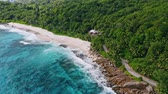 bizarro : Aerial panoramic 4K drone shot of white sand paradise tropical beach Anse Bazarca at Mahe island, Seychelles. Summer vacation, travel and lifestyle concept