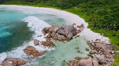 mavic : Aerial drone footage of tropical beach Anse Coco. Paradise like blue lagoon and rainforest around. La Digue island, Seychelles Stock Footage