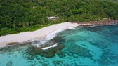 雄大な : Aerial footage of tropical beach with white sand beach and crystal clear water and coral reef at Mahe Island, Seychelles