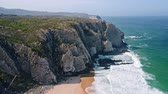 portugalia : Aerial view of rocky wall formation on Praia Grande beach located on Portugal coastline with Atlantic ocean