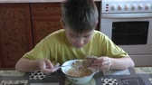 borscht : The boy eats a borshch with appetite Stock Footage