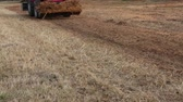 front end loader : Red tractor passing by with a front end loader full of dirt. Stock Footage