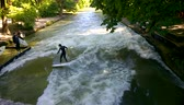 Munich, Germany  How to surf in Munich Easy! in central Englischer Garten in one of the many channels crossing this wide park, a big artificial wave is generated on a concrete step. The place is narrow and dangerous