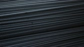 tied up : ribbed steel bars in warehouse from up to down close up Stock Footage
