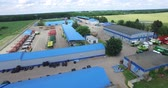 the blue roofs of warehouses and the fleet of agricultural machinery Stock Footage