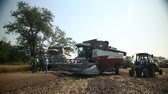 on a cleaned area of the field is agricultural machinery Dostupné videozáznamy