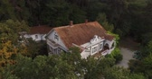 fotografia : aerial photography of the house in the forest, highlands