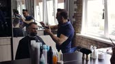 barber hair cut : Hairdresser makes a mans haircut in the Barber shop