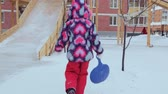 cold winter : Child wallking to the slides at playground Stock Footage