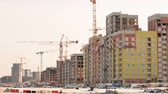 many storied : Buildings under construction at building site Stock Footage