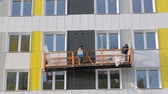 postavit : Builders working on elevator at building site